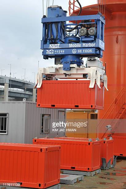 The Mobile Harbour's stabilised crane demonstrates off the southern port of Busan on June 29 2011 South Korean researchers showcased an invention...