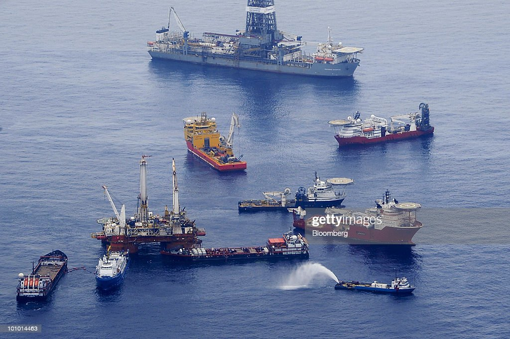 The mobile offshore drilling unit Q4000, foreground left, holds position directly over the damaged Deepwater Horizon blowout preventer as crews work to plug the wellhead using a technique known as 'top kill' in the Gulf of Mexico, on Wednesday, May 26, 2010. BP Plc temporarily stopped the flow from the leaking Macondo well in the Gulf of Mexico, indicating progress on its plans to plug a well that's been spewing oil for more than a month, U.S. Coast Guard Admiral Thad Allen said. Photographer: Ann Marie Gorden /U.S. Coast Guard via Bloomberg