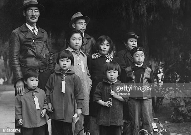The Mochida Family awaits a bus that will eventually take them to an interment camp They along with some 112000 other Japanese Americans were kept in...