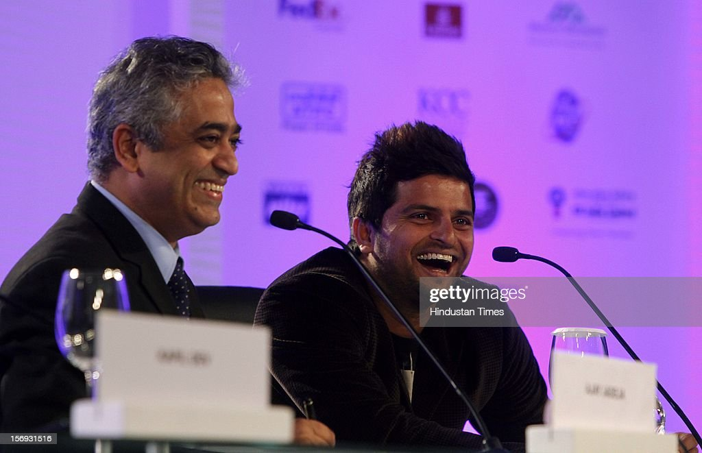 The modarator Rajdeep Sardesai and Indian cricketer Suresh Raina laugh during the sixth session of Hindustan Times Leadership Summit at Taj Palace in New Delhi on Friday, November 16, 2012.
