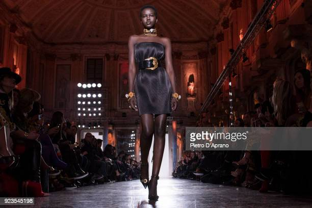 The model Adut Akech walks the runway at the Versace show during Milan Fashion Week Fall/Winter 2018/19 on February 23 2018 in Milan Italy