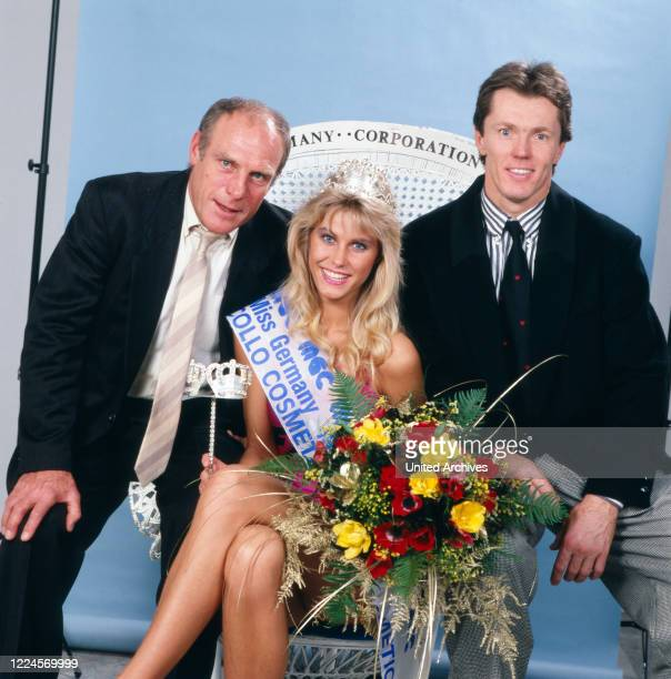 The Model and Miss Germany, 1988/1989 Nicole Reinhardt poses with men after her coronation, Germany Cologne 1989.