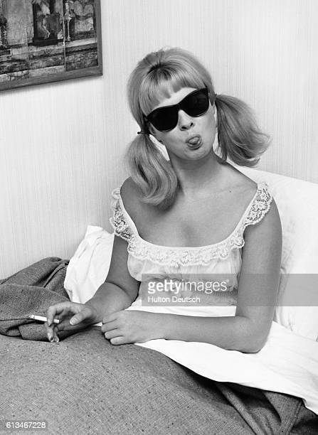 The model and show girl Mandy RiceDavies at home in bed 1963