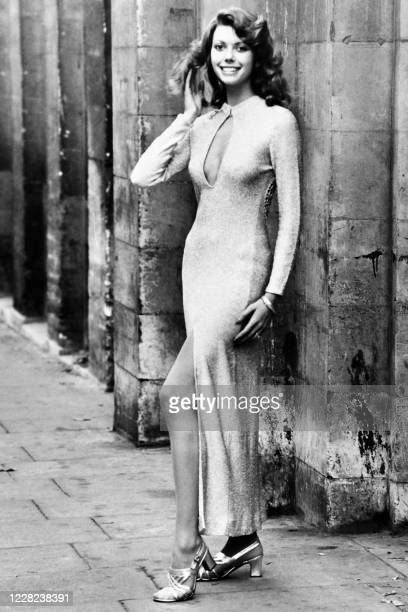 The model Delia Whittaker presents a creation a split lurex dress on October 27 1972 during the London fashion exhibition in London