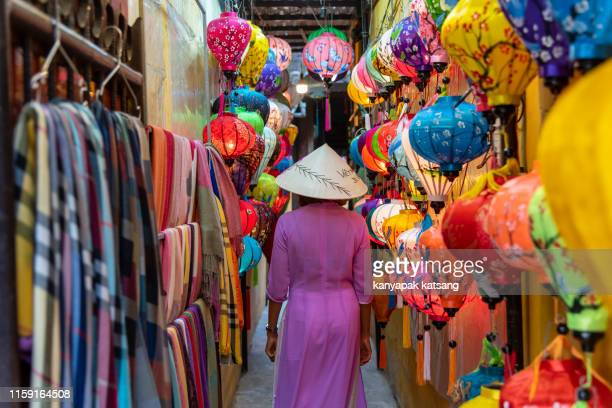 the model  in vietnam  local dress in  hoi an lampions   shop. - traditional clothing stock photos and pictures