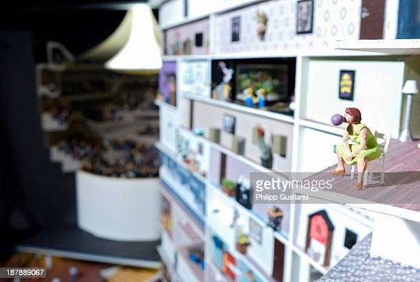 The model of a woman chewing bubble gum is seen in a section of the miniature Elbe Philharmonic Hall at the Miniatur Wunderland on November 13 2013...