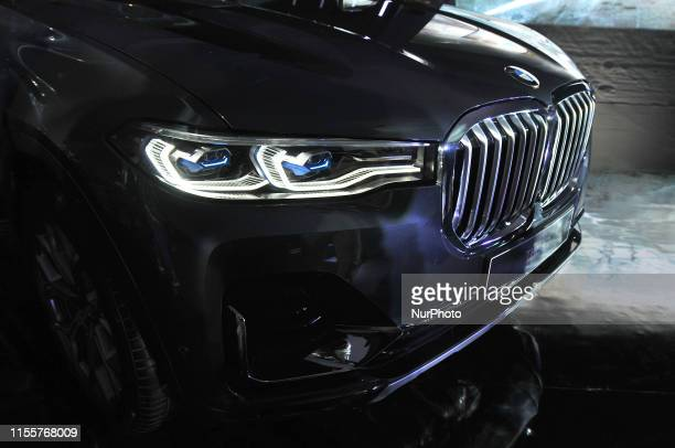 The model poses in the BMW X7 at its launch in Jakarta, July 2019. BMW X7 xDrive40i Pure Excellence is an SUV that is equipped with a 3.0-liter...