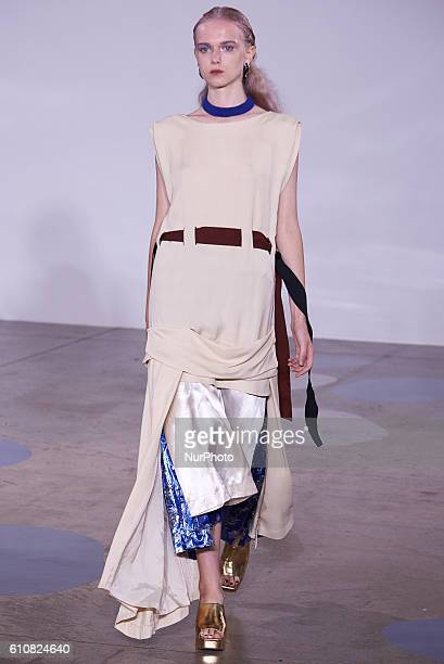 The model waslk down the runway wearing Toga's spring/summer 17 collection at London Fashion Week on September 20th 2016
