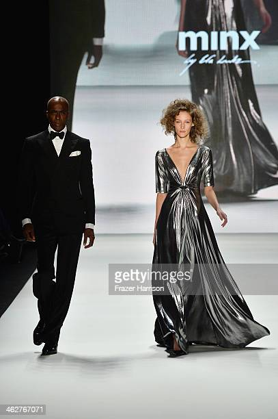 The models Bruce Darnell and Franzi Mueller walk the runway at the Minx by Eva Lutz show during MercedesBenz Fashion Week Autumn/Winter 2014/15 at...