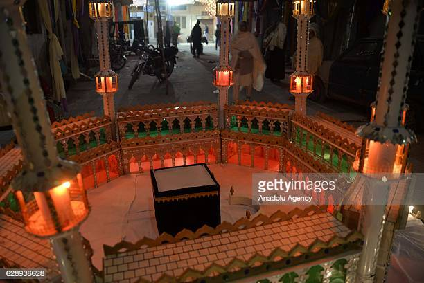 The models of the holy places in Mecca Saudi Arabia are illuminated with lights on the eve of Mawlid alNabi to celebrate the 1445th birth anniversary...