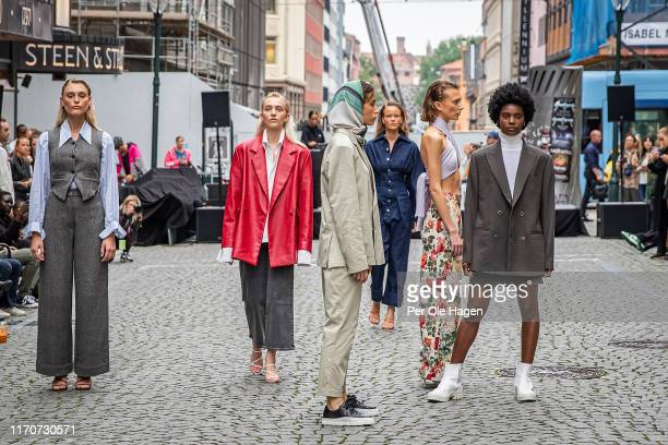 The models walk the runway at the street viewing of Norwegian Design at the opening of the Richie Talboy and Yael Quint Exhibition at the Fushion...