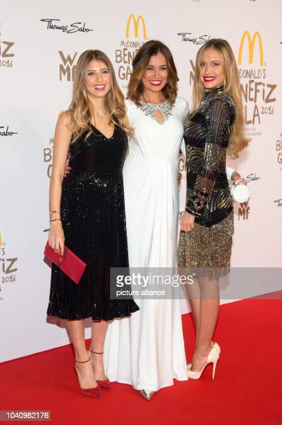 The moderator Cathy Hummels Jana Ina Zarrella and model Alena Gerber arrive at the McDonald's Charity Gala in Munich Germany 20 October 2016 The...