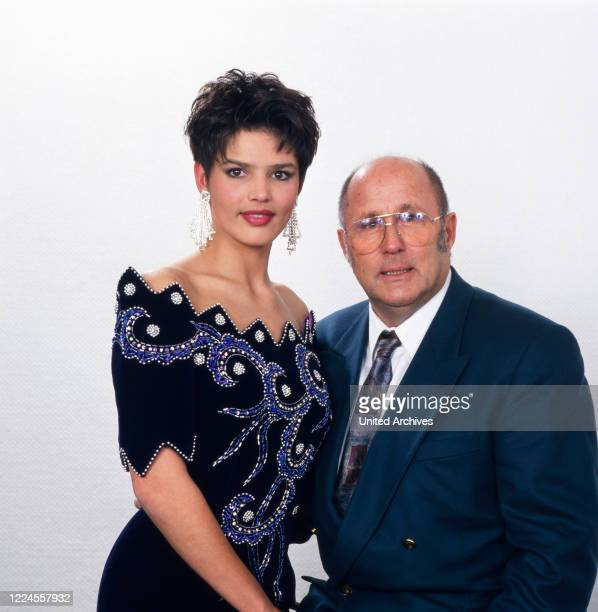 The moderator of the Miss Universe election on 5th December 1992 Erich Reindl posing with Miss Germany, 1992 Ines Kuba for a photo.