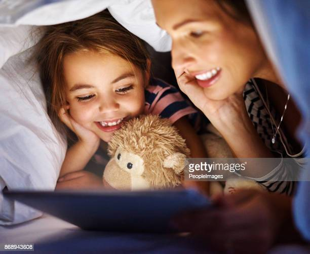 the modern bedtime story - super mom stock photos and pictures
