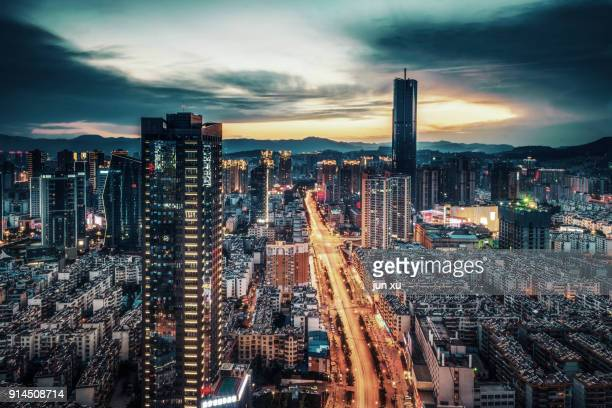 the modern city skyline - kunming stock pictures, royalty-free photos & images