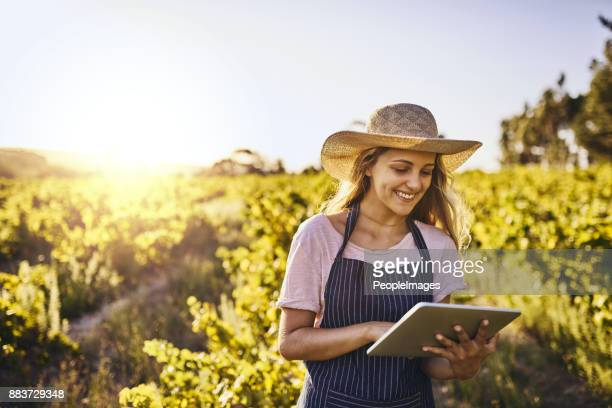 the modern farmer's little helper - farm woman stock pictures, royalty-free photos & images