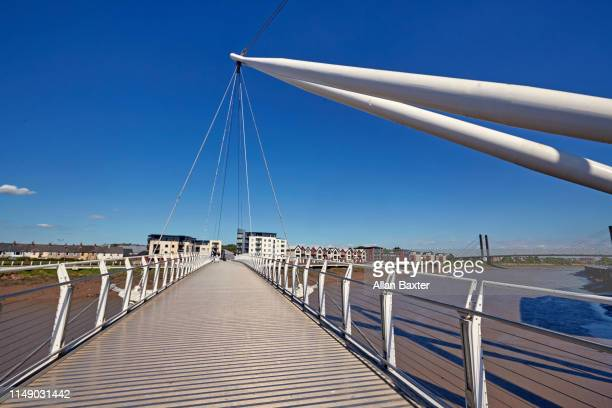 the modern 'newport city footbridge' in newport, architect grimshaw - newport wales photos stock pictures, royalty-free photos & images