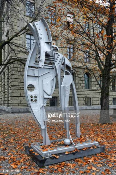 "the modern sculpture ""silver ghost""in the garden of zurich university premises. - emreturanphoto stock pictures, royalty-free photos & images"