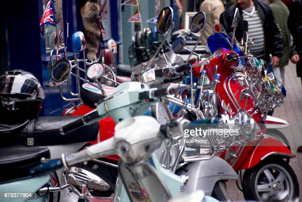 The Mods are pictured while gather with their scooters at Carnaby Street London on April 30 2017 Tens of Italian scooters appeared at the world...