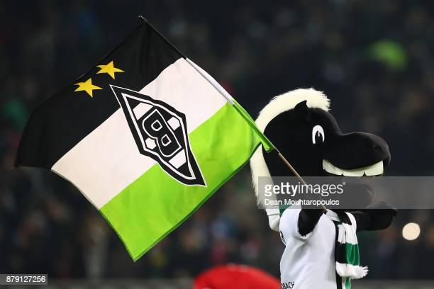 The Moenchengladbach mascot celebrates after the Bundesliga match between Borussia Moenchengladbach and FC Bayern Muenchen at BorussiaPark on...
