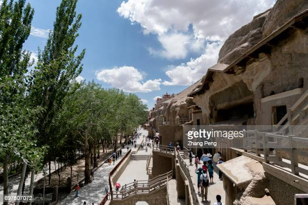 The Mogao Caves also known as the Thousand Buddha Grottoes are the best known of the Chinese Buddhist grottoes along with Longmen Grottoes and...