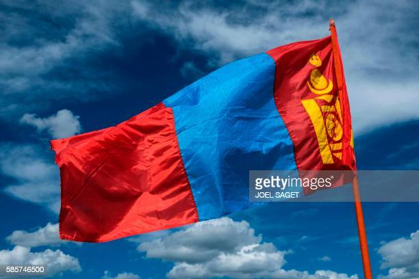The mogolian flag is pictured on July 17 2016 during the traditionnal Nadaam festival in the Ovorkhangai province / AFP / JOEL SAGET