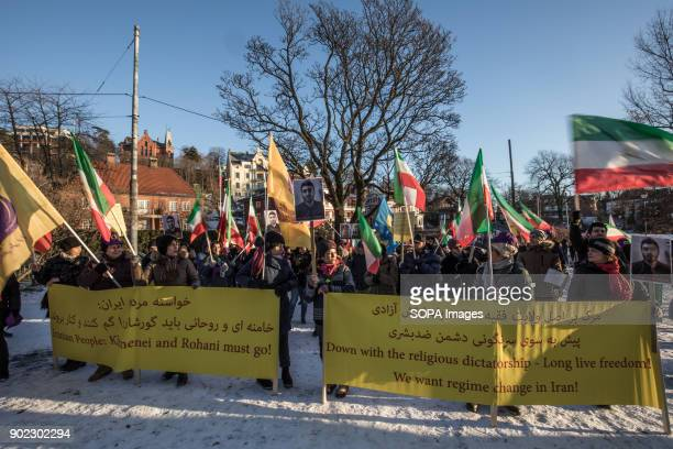 The Mojahedin Organization of Iran members seen protesting outside the Iranian embassy in Oslo while condemning the killings and crackdown of...
