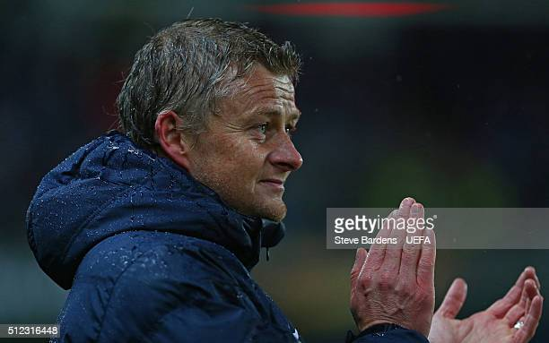 The Molde manager Ole Gunnar Solskjaer applauds the home supporters after the UEFA Europa League Round of 32 second leg match between Molde and...