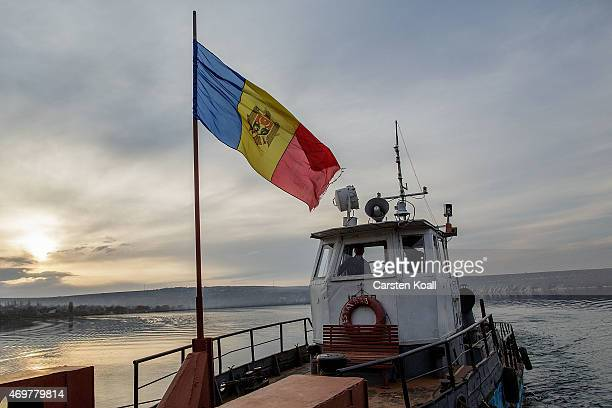 The moldovian flag waves in the wind on a ferry on March 10, 2015 in Molovata near Chisinau, Moldova. The ferry crosses the river Nistru. Most of...