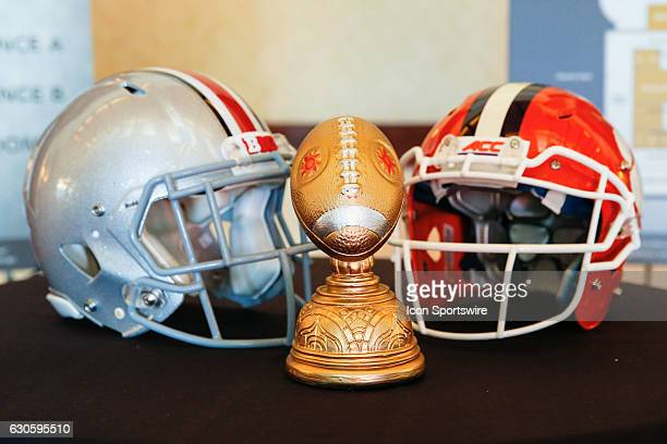 The Molina Fiesta Bowl trophy surrounded by Ohio State and Clemson helmets at the Fiesta Bowl Press Conference on December 27 2016 at the JW Marriott...