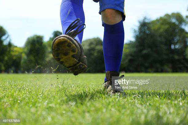 the moment after a football is kicked - cleats stock pictures, royalty-free photos & images