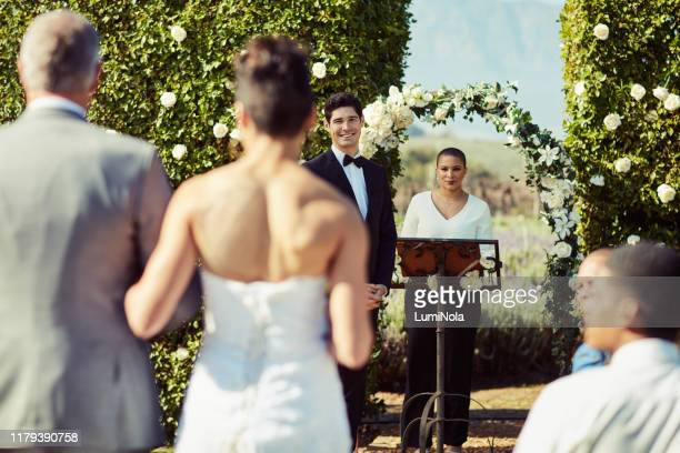 the moment he saw his bride for the first time - altar stock pictures, royalty-free photos & images