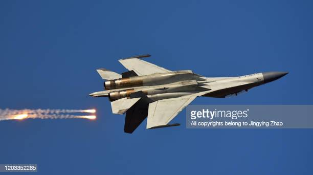 the moment of a chinese air force fighter launching jamming bombs - war stock pictures, royalty-free photos & images