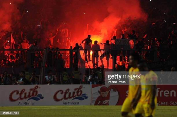 The moment of celebration of Persib supporters seeing their team winning the Presidents tournament championship 2015 Football team Persib of Bandung...