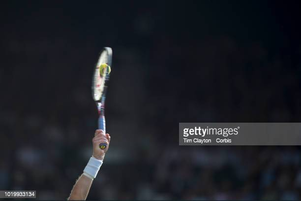 The moment of impact as the racquet strikes the ball as Kevin Anderson of South Africa serves against John Isner of the United States in the Men's...