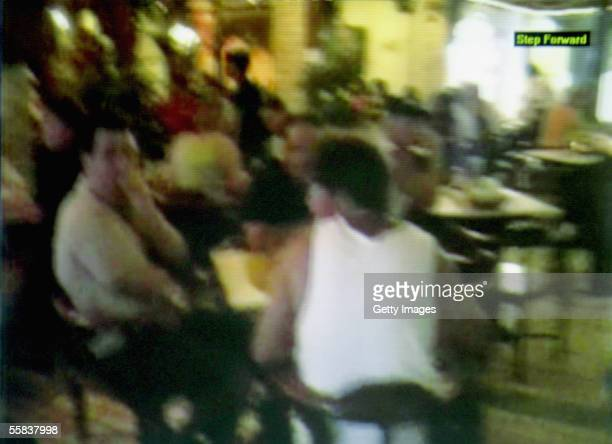 The moments leading up to the explosion that ripped through a restaurant in the resort of Kuta are seen in this grab taken from a tourists amateur...
