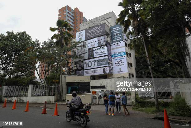 The Monaco building which was once home to Colombian drug lord Pablo Escobar is seen covered with pictures of victims of his Medellin Cartel in...