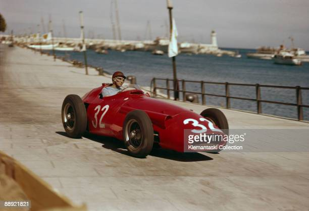 The Monaco Grand Prix; Monte Carlo, May 19, 1957. Juan Manuel Fangio in his Maserati 250F on the approach to Tabac Corner on the harbor front.