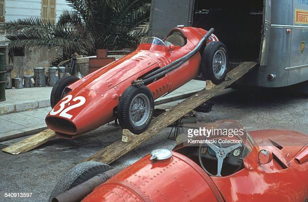 The Monaco Grand Prix Monte Carlo May 19 1957 Juan Manuel Fangio's Maserati 250F is prepared for some mechanical attention on a Monaco side street