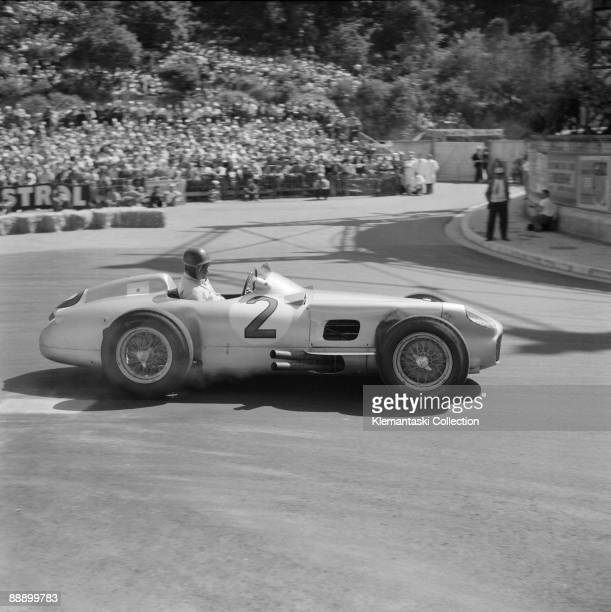 The Monaco Grand Prix Monte Carlo May 22 1955 The great Juan Manuel Fangio rounds the old Gazometer hairpin at the end of the harbor straight in his...
