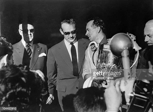 The Monaco Grand Prix was won by the French pilot Maurice TRINTIGNATN driving a FERRARI Prince RAINIER OF MONACO gave him the trophy