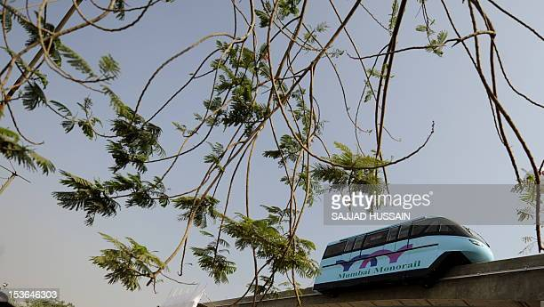 The Monarail car runs along the track during the trial run of the first Monorail in Mumbai on January 26 2010 The Malaysiabased Scomi Group in joint...