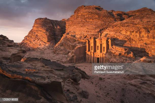 the monastery or ad deir at beautiful sunset in petra ruin and ancient city, jordan, arab - jordanian stock pictures, royalty-free photos & images