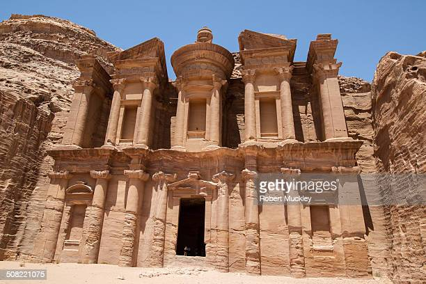 CONTENT] The Monastery or AlDeir at Petra Carved out of solid read sand stone A single person in the doorway shows how huge the structure is
