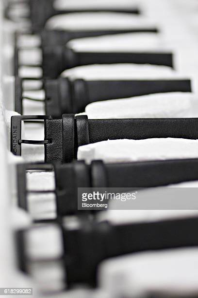 The Mondaine logo sits engraved on the buckle of leather wristwatch straps ahead of their assembly at the Mondaine Watch Ltd production facility in...