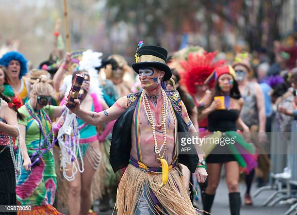 The Mondo Kayo Social and Marching Club make their way along the parade route on St Charles Avenue during the Mardi Gras parade on Fat Tuesday in New...