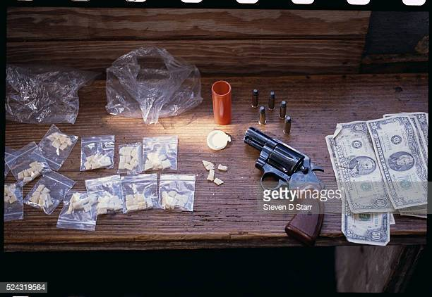 The money revolver and bags of crack cocaine were seized during a raid on a crack house which was being run by an 82yearold man