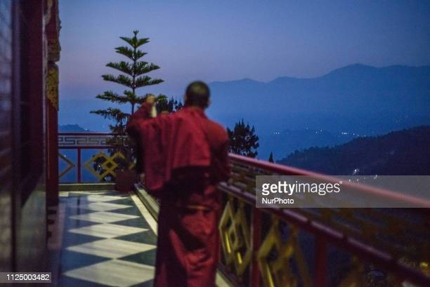 The monk beats the gong convening everyone for the morning prayer in the Thrangu Tashi Yangtse Monastery Kavrepalanchok District Bagmati Zone Nepal...