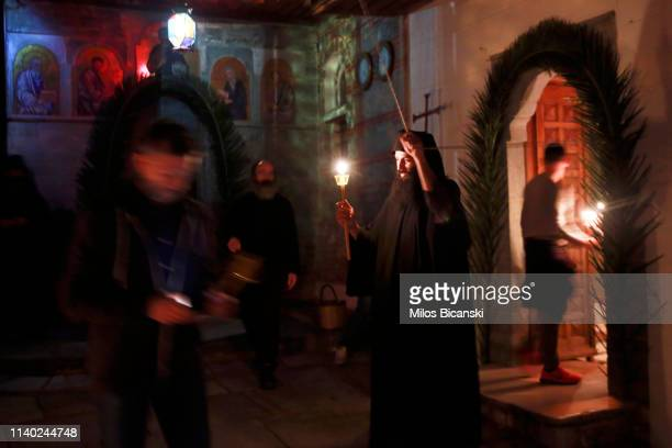 The Monk of a Osiou Gregoriou monastery Father Nikodimos rings a church bell during the Easter Sunday Mass at the Osiou Gregoriou monastery on April...