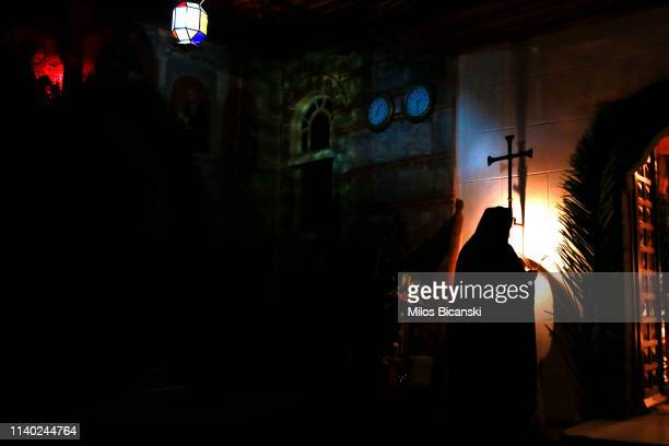 The Monk of a Osiou Gregoriou monastery rings a church bell during the Easter Sunday Mass at the Osiou Gregoriou monastery on April 28 2019 in Moint...